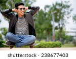 young man sitting on the...   Shutterstock . vector #238677403