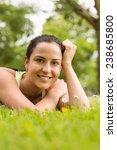 smiling fit brunette lying on... | Shutterstock . vector #238685800