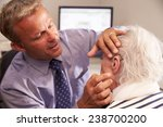 doctor fitting senior female... | Shutterstock . vector #238700200