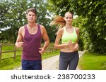 couple on run in countryside... | Shutterstock . vector #238700233