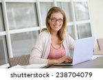 middle aged woman working from... | Shutterstock . vector #238704079