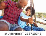 father and son having fun on... | Shutterstock . vector #238710343