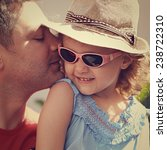 happy father kissing his... | Shutterstock . vector #238722310