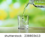 pouring water from bottle on ...   Shutterstock . vector #238803613