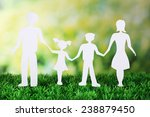 paper family on green grass on... | Shutterstock . vector #238879450