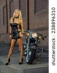 sexy motorcycle biker girl... | Shutterstock . vector #238896310
