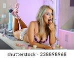 sexy blonde girl in kitchen  | Shutterstock . vector #238898968