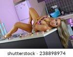 sexy blonde girl in kitchen  | Shutterstock . vector #238898974