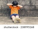 girl closing her ears sitting... | Shutterstock . vector #238995268