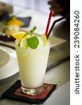 lemon blend with piece of lemon ... | Shutterstock . vector #239084260