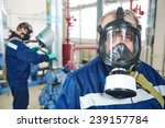 Small photo of portrait of service engineer worker with gas mask at industrial compressor station for refrigeration or ammoniac chiller system at factory