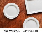square plate on the wood... | Shutterstock . vector #239196118