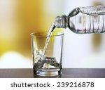 Pouring Water From Bottle On ...