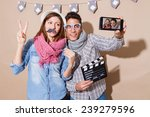 Stock photo young couple in a photo booth party with gesture face taking selfie 239279596