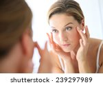 middle aged woman applying anti ... | Shutterstock . vector #239297989
