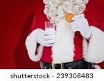 Santa Holding Glass Of Milk An...