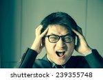 young asian man shouting | Shutterstock . vector #239355748