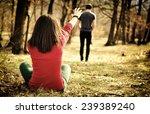 young couple breaking up. girl...   Shutterstock . vector #239389240