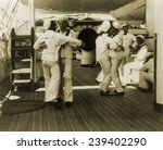 Small photo of Sailors aboard the USS OLYMPIA waltzing at tiffin (lunch time), 1899. The USS OLYMPIA was Admiral Dewey's flagship and is now a museum ship at the Independence Seaport Museum, Philadelphia.