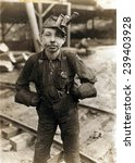 Small photo of Child laborer portrayed by Lewis Hine in 1908. Tipple Boy at West Virginia coal mine, worked with the tipple, a device that tilted coal cars from the mine for unloading.