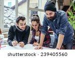 teamwork. three young... | Shutterstock . vector #239405560