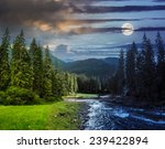 collage day and night landscape with pine trees in mountains and a river in front flowing to lake with full moon - stock photo