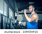 young adult man drinking bottle ... | Shutterstock . vector #239454910