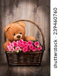 roses and a teddy bear in the... | Shutterstock . vector #239460760