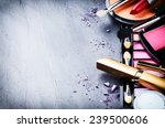 Various Makeup Products On Dar...