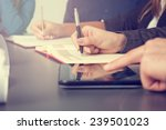 business team taking notes on a ... | Shutterstock . vector #239501023