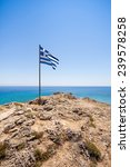 Greek Flag On The Cliff With...