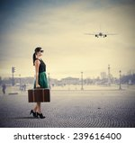 woman classy traveller walks in ... | Shutterstock . vector #239616400