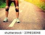 tired woman runner taking a...   Shutterstock . vector #239818048
