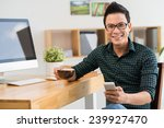 happy young man with a... | Shutterstock . vector #239927470
