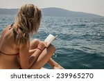 young woman reading a book at... | Shutterstock . vector #239965270