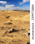 Golden sand in the Sahara desert - stock photo