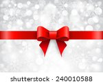 red satin bow on shiny silver... | Shutterstock . vector #240010588