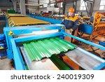 industrial worker operating...