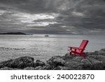 Red Chair On Ocean Side Rocks...