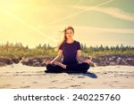 young women practices yoga on... | Shutterstock . vector #240225760