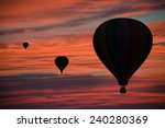 hot air balloons floating among ... | Shutterstock . vector #240280369