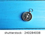 Compass On Blue Wooden...