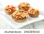 stuffed mushrooms on plate on... | Shutterstock . vector #240285010