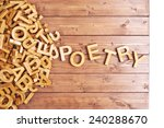 Small photo of Word poetry made with block wooden letters next to a pile of other letters over the wooden board surface composition