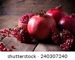 some red juicy pomegranate ... | Shutterstock . vector #240307240