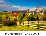 Red Barn On A Farm In Rural...