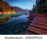 wooden walkway along scenic... | Shutterstock . vector #240459514