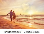 couple walking on the beach at... | Shutterstock . vector #240513538
