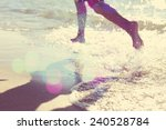 child running at the beach ... | Shutterstock . vector #240528784