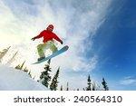 snowboarder jumping through air ... | Shutterstock . vector #240564310